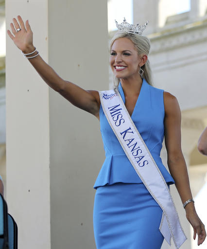 <div class='meta'><div class='origin-logo' data-origin='none'></div><span class='caption-text' data-credit='AP'>In this Tuesday, Aug. 30, 2016 photograph, Miss Kansas, Kendall Ellen Schoenekase waves as she is introduced during Miss America Pageant arrival ceremonies in Atlantic City.</span></div>