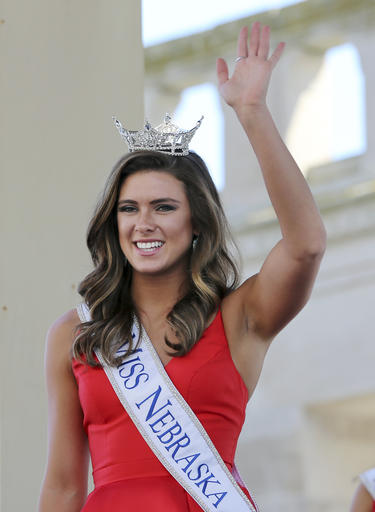 <div class='meta'><div class='origin-logo' data-origin='none'></div><span class='caption-text' data-credit='AP'>In this Tuesday, Aug. 30, 2016 photograph, Miss Nebraska, Aleah Peters waves as she is introduced during Miss America Pageant arrival ceremonies in Atlantic City.</span></div>