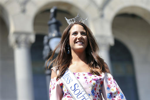 <div class='meta'><div class='origin-logo' data-origin='none'></div><span class='caption-text' data-credit='AP'>In this Tuesday, Aug. 30, 2016 photograph, Miss South Dakota, Julia Olson is introduced during Miss America Pageant arrival ceremonies in Atlantic City.</span></div>