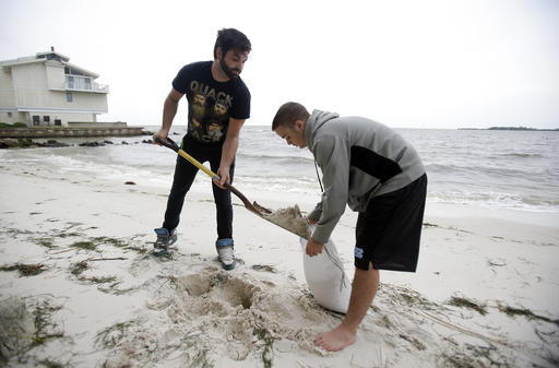 "<div class=""meta image-caption""><div class=""origin-logo origin-image none""><span>none</span></div><span class=""caption-text"">Daniel Fink, left, and Pete Stefani fill sandbags at the Cedar Cove Hotel as they prepare for Tropical Storm Hermine Thursday, Sept. 1 in Cedar Key, Fla. (AP Photo/John Raoux) (AP)</span></div>"