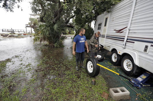 "<div class=""meta image-caption""><div class=""origin-logo origin-image none""><span>none</span></div><span class=""caption-text"">Spyridon Aibejeris, left, helps his neighbors pull out a trailer off their property along the Gulf of Mexico in advance of Tropical Storm Hermine Sept. 1, 2016, in Keaton Beach (AP)</span></div>"