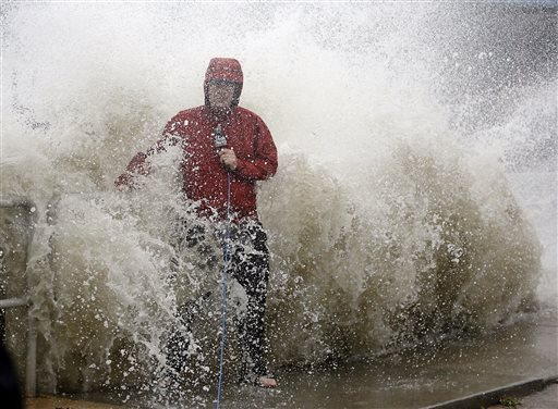 "<div class=""meta image-caption""><div class=""origin-logo origin-image none""><span>none</span></div><span class=""caption-text"">A news reporter doing a stand up near a sea wall in Cedar Key, Fla., is covered by an unexpected wave as Hurricane Hermine nears the Florida coast, Thursday, Sept. 1, 2016. (AP)</span></div>"