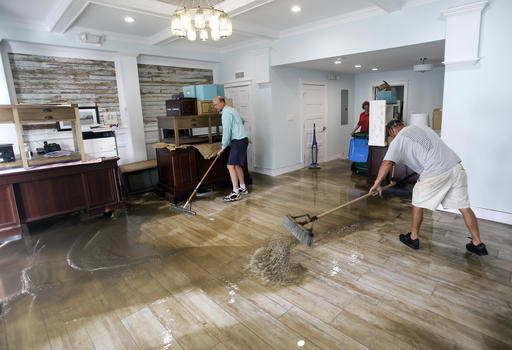 "<div class=""meta image-caption""><div class=""origin-logo origin-image none""><span>none</span></div><span class=""caption-text"">Shawn Stephenson, left, and Marshall Dimick clear water from a real estate office that was flooded by Hurricane Hermine Friday, Sept. 2, 2016, in Cedar Key, Fla. (AP)</span></div>"