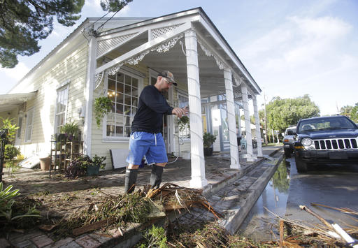 "<div class=""meta image-caption""><div class=""origin-logo origin-image ap""><span>AP</span></div><span class=""caption-text"">Pat Bonish moves debris off the sidewalk in downtown Cedar Key, Fla. after Hurricane Hermine passed through Friday, Sept. 2, 2016. (AP)</span></div>"