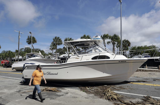 "<div class=""meta image-caption""><div class=""origin-logo origin-image none""><span>none</span></div><span class=""caption-text"">A woman walks past pleasure boats that were washed into Riverside Dr., when Hurricane Hermine came ashore early Friday, Sept. 2, 2016, in Steinhatchee, Fla. (AP)</span></div>"