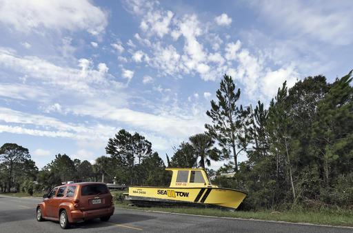 "<div class=""meta image-caption""><div class=""origin-logo origin-image ap""><span>AP</span></div><span class=""caption-text"">Motorists drive by a boat that was tossed onto the road when winds from Hurricane Hermine came ashore early Friday, Sept. 2, 2016, in Dekle Beach, Fla. (AP)</span></div>"