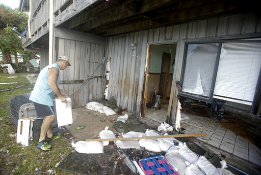 "<div class=""meta image-caption""><div class=""origin-logo origin-image none""><span>none</span></div><span class=""caption-text"">Bill Heckler picks up some of his belongings that were damaged in his condominium from Hurricane Hermine Friday, Sept. 2, 2016, in Cedar Key, Fla. (AP)</span></div>"
