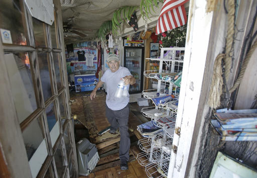 "<div class=""meta image-caption""><div class=""origin-logo origin-image none""><span>none</span></div><span class=""caption-text"">Gus Soldatos steps over a hole in the floor as  he brings water out of his son's bait shop after Hurricane Hermine Friday, Sept. 2, 2016, in Cedar Key, Fla. (AP)</span></div>"