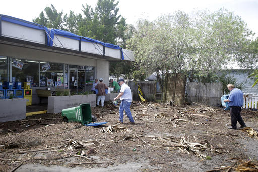 "<div class=""meta image-caption""><div class=""origin-logo origin-image none""><span>none</span></div><span class=""caption-text"">Workers clean up debris, caused by Hurricane Hermine, in the parking lot in front of convenience store, Friday, Sept. 2, 2016, in Cedar Key, Fla. (AP)</span></div>"