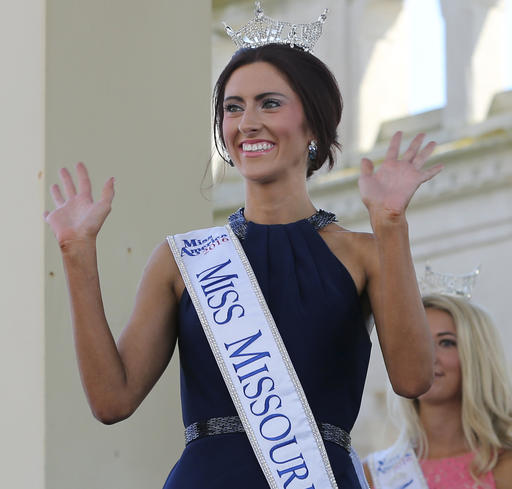 <div class='meta'><div class='origin-logo' data-origin='none'></div><span class='caption-text' data-credit='AP'>In this Tuesday, Aug. 30, 2016 hoto, Miss Missouri, Erin O'Flaherty waves as she is introduced during Miss America Pageant arrival ceremonies in Atlantic City.</span></div>