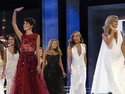 <div class='meta'><div class='origin-logo' data-origin='none'></div><span class='caption-text' data-credit='AP'>Contestants in the evening gown portion of the Miss America pageant compete on the first night of preliminary competition in Atlantic City</span></div>