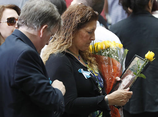 "<div class=""meta image-caption""><div class=""origin-logo origin-image ap""><span>AP</span></div><span class=""caption-text"">A mourner holds a photo of her loved one during the 15th anniversary of the attacks of the World Trade Center at the National September 11 Memorial, Sunday, Sept. 11, 2016. (AP Photo/Mary Altaffer)</span></div>"