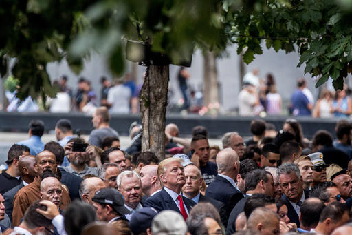 "<div class=""meta image-caption""><div class=""origin-logo origin-image ap""><span>AP</span></div><span class=""caption-text"">Republican presidential candidate Donald Trump, center, attends a ceremony at the Sept. 11 memorial, in New York, Sunday, Sept. 11, 2016. (AP Photo/Andrew Harnik)</span></div>"