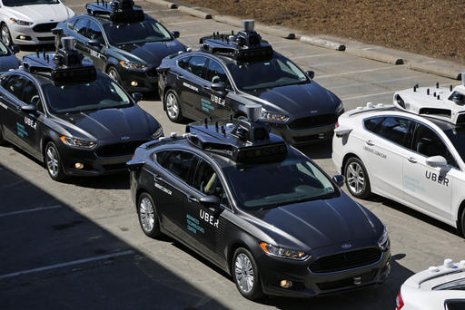 <div class='meta'><div class='origin-logo' data-origin='AP'></div><span class='caption-text' data-credit='AP Photo/Gene J. Puskar)'>A group of self driving Uber vehicles position themselves to take journalists on rides during a media preview at Uber's Advanced Technologies Center in Pittsburgh.</span></div>