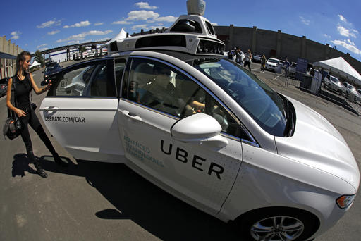 <div class='meta'><div class='origin-logo' data-origin='AP'></div><span class='caption-text' data-credit='AP Photo/Gene J. Puskar)'>A journalist gets in a self driving Uber for a ride during a media preview at Uber's Advanced Technologies Center in Pittsburgh Monday, Sept. 12, 2016.</span></div>