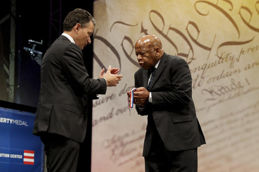 "<div class=""meta image-caption""><div class=""origin-logo origin-image ap""><span>AP</span></div><span class=""caption-text"">Rep. John Lewis, right, D-Ga., reacts after being presented with the Liberty Medal for his dedication to civil rights from National Constitution Center CEO Jeffrey Rosen. (AP Photo/Matt Slocum)</span></div>"