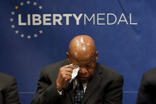 "<div class=""meta image-caption""><div class=""origin-logo origin-image ap""><span>AP</span></div><span class=""caption-text"">Rep. John Lewis, D-Ga., wipes his face during a ceremony where he was being presented with the Liberty Medal for his dedication to civil rights at the National Constitution Center. (AP Photo/Matt Slocum)</span></div>"