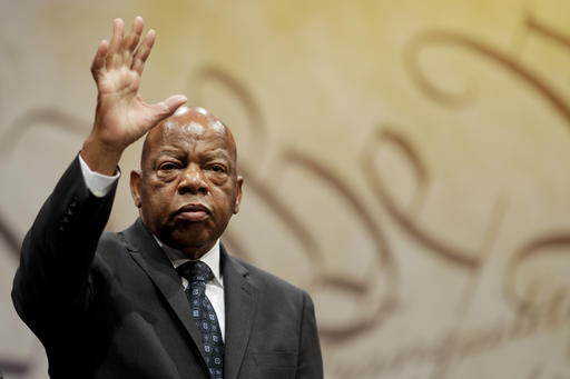 "<div class=""meta image-caption""><div class=""origin-logo origin-image ap""><span>AP</span></div><span class=""caption-text"">Rep. John Lewis, D-Ga., waves after being presented with the Liberty Medal for his dedication to civil rights during a ceremony at the National Constitution Center. (AP Photo/Matt Slocum)</span></div>"