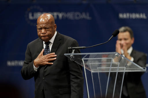 "<div class=""meta image-caption""><div class=""origin-logo origin-image ap""><span>AP</span></div><span class=""caption-text"">Rep. John Lewis, D-Ga., reacts after being presented with the Liberty Medal for his dedication to civil rights during a ceremony at the National Constitution Center. (AP Photo/Matt Slocum)</span></div>"