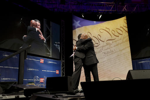 "<div class=""meta image-caption""><div class=""origin-logo origin-image ap""><span>AP</span></div><span class=""caption-text"">Rep. John Lewis, right, D-Ga., hugs National Constitution Center CEO Jeffrey Rosen after Lewis was presented with the Liberty Medal for his dedication to civil rights. (AP Photo/Matt Slocum)</span></div>"