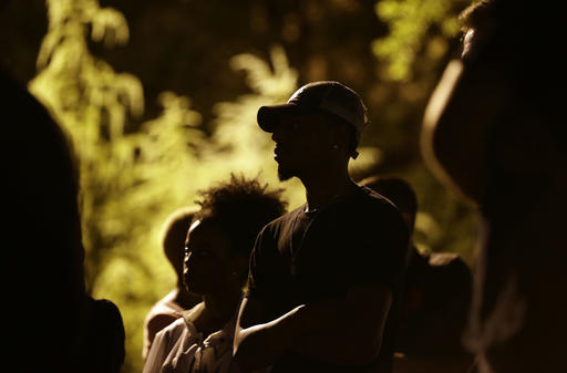 "<div class=""meta image-caption""><div class=""origin-logo origin-image none""><span>none</span></div><span class=""caption-text"">People gather for a vigil at the scene of Tuesday's police shooting of Keith Lamont Scott at The Village at College Downs apartment complex in Charlotte, N.C. (AP)</span></div>"