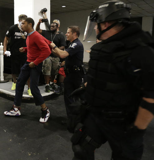 "<div class=""meta image-caption""><div class=""origin-logo origin-image none""><span>none</span></div><span class=""caption-text"">A man is detained by police during a protest of Tuesday's fatal police shooting of Keith Lamont Scott in Charlotte, N.C. on Wednesday, Sept. 21, 2016. (AP)</span></div>"