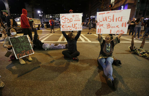 "<div class=""meta image-caption""><div class=""origin-logo origin-image none""><span>none</span></div><span class=""caption-text"">Demonstrators sit on a street during a protest of Tuesday's fatal police shooting of Keith Lamont Scott in Charlotte, N.C. on Wednesday, Sept. 21, 2016. (AP)</span></div>"