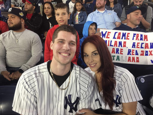 "<div class=""meta image-caption""><div class=""origin-logo origin-image ap""><span>AP</span></div><span class=""caption-text"">Andrew Fox, left, and Heather Terwilliger sit in the stands at Yankee Stadium on Tuesday night, Sept. 27, 2016, in New York. (AP Photo/Kathy Willens)</span></div>"