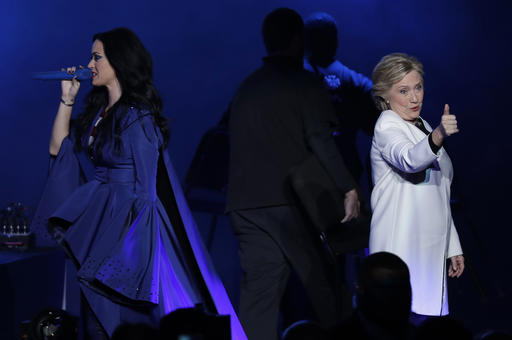<div class='meta'><div class='origin-logo' data-origin='AP'></div><span class='caption-text' data-credit='AP'>Katy Perry, left, addresses the crowd during a concert supporting Democratic presidential candidate, Hillary Clinton, right, at the Mann Center for the Performing Arts.</span></div>