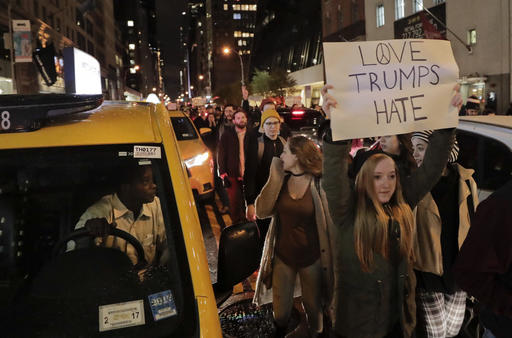 <div class='meta'><div class='origin-logo' data-origin='AP'></div><span class='caption-text' data-credit='AP Photo/Julie Jacobson'>Protesters march along 57th Street toward Trump Tower, Wednesday, Nov. 9, 2016, in New York, in opposition of Donald Trump's presidential election victory.</span></div>