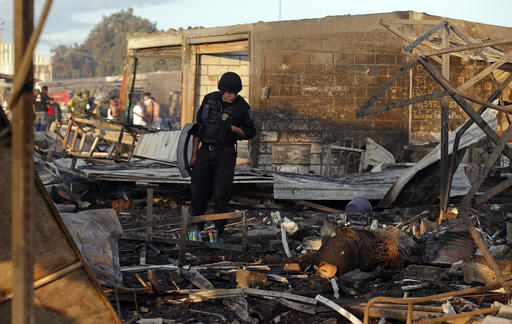 "<div class=""meta image-caption""><div class=""origin-logo origin-image ap""><span>AP</span></div><span class=""caption-text"">A Mexico State policeman looks through the scorched ground of the open-air San Pablito fireworks market, in Tultepec, outskirts of Mexico City. (AP Photo/Eduardo Verdugo)</span></div>"