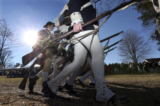 <div class='meta'><div class='origin-logo' data-origin='AP'></div><span class='caption-text' data-credit='AP Photo/Mel Evans'>Re-enactors march as they prepare to re-enact Gen. George Washington's daring Christmas 1776 crossing of the river, the trek that turned the tide of the Revolutionary War.</span></div>