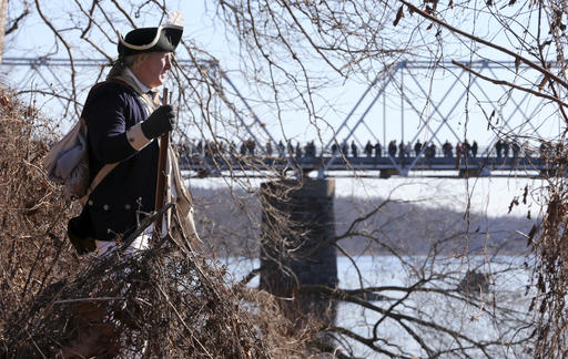 <div class='meta'><div class='origin-logo' data-origin='AP'></div><span class='caption-text' data-credit='AP Photo/Mel Evans'>As people line a bridge, a sentry watches from the brambles during the reenactment of Gen. George Washington's Christmas Day crossing of the Delaware River to New Jersey.</span></div>