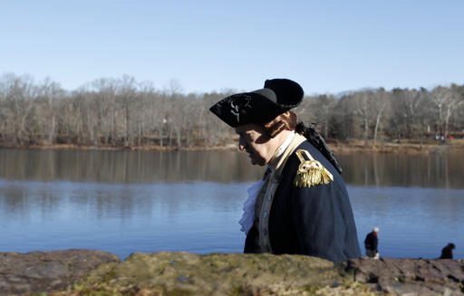 <div class='meta'><div class='origin-logo' data-origin='AP'></div><span class='caption-text' data-credit='AP Photo/Mel Evans'>John Godzieba as Gen. George Washington, walks along the bank of the Delaware River before the re-enactment of Washington's Christmas 1776 crossing of the river.</span></div>