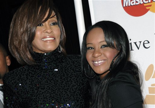 <div class='meta'><div class='origin-logo' data-origin='none'></div><span class='caption-text' data-credit='AP'>FILE - In this Feb. 12, 2011, file photo, singer Whitney Houston, left, and daughter Bobbi Kristina Brown arrive at an event in Beverly Hills, Calif.</span></div>