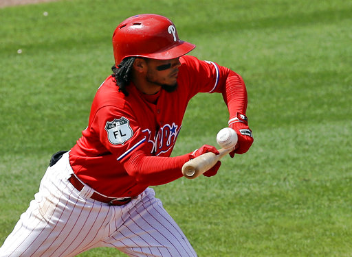 "<div class=""meta image-caption""><div class=""origin-logo origin-image ap""><span>AP</span></div><span class=""caption-text"">Philadelphia Phillies' Freddy Galvis bunts a pop fly for an out in the sixth inning of a spring training baseball game against the Tampa Bay Rays, Friday, March 31, 2017. (AP)</span></div>"