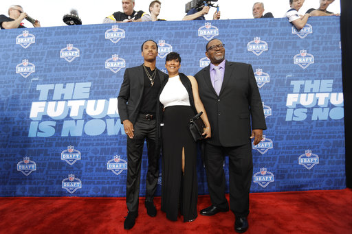 <div class='meta'><div class='origin-logo' data-origin='AP'></div><span class='caption-text' data-credit='AP'>Washington's Kevin King arrives for the first round of the 2017 NFL football draft, Thursday, April 27, 2017, in Philadelphia. (AP Photo/Julio Cortez)</span></div>