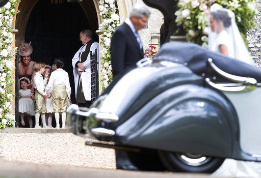 "<div class=""meta image-caption""><div class=""origin-logo origin-image none""><span>none</span></div><span class=""caption-text"">Pippa Middleton is escorted by her father, Michael Middleton, as she arrives for her wedding to James Matthews, Saturday, May 20, 2017. (AP)</span></div>"