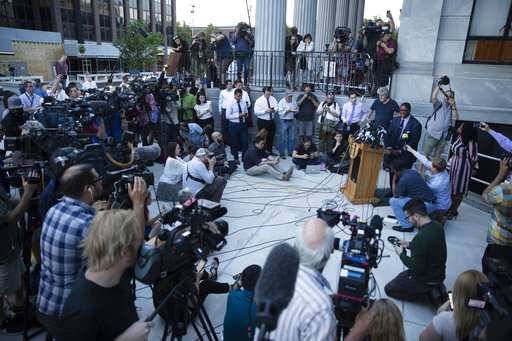 <div class='meta'><div class='origin-logo' data-origin='AP'></div><span class='caption-text' data-credit='(AP Photo/Matt Rourke)'>Bill Cosby's spokesman Andrew Wyatt speaks with members of the media during jury deliberations on Thursday, June 15, 2017.</span></div>