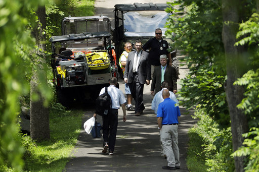 <div class='meta'><div class='origin-logo' data-origin='none'></div><span class='caption-text' data-credit='AP'>Law enforcement officials walk down a blocked off drive way, Monday, July 10, 2017, in Solebury, Pa.  (AP Photo/Matt Slocum)</span></div>