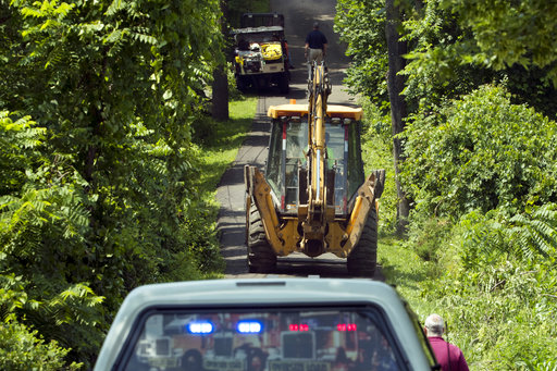 <div class='meta'><div class='origin-logo' data-origin='none'></div><span class='caption-text' data-credit='AP'>Construction equipment and law enforcement officials head down a blocked off drive way, Monday, July 10, 2017, in Solebury, Pa.  (AP Photo/Matt Slocum)</span></div>