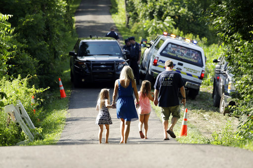 <div class='meta'><div class='origin-logo' data-origin='none'></div><span class='caption-text' data-credit='AP'>A family walks down a blocked off drive way, Monday, July 10, 2017, in Solebury, Pa.  (AP Photo/Matt Slocum)</span></div>