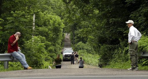 <div class='meta'><div class='origin-logo' data-origin='none'></div><span class='caption-text' data-credit='AP'>Men gather at the entrance to a blocked off drive way, in Solebury, Pa., on Tuesday, July 11, 2017. (AP Photo/Matt Slocum)</span></div>