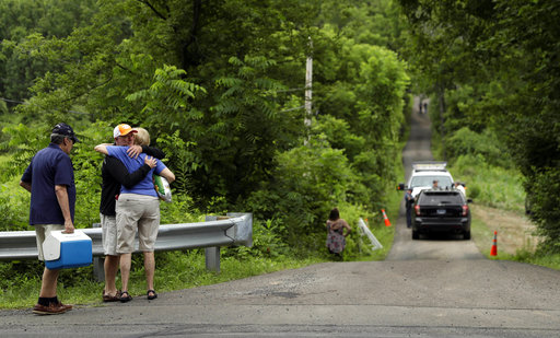 <div class='meta'><div class='origin-logo' data-origin='none'></div><span class='caption-text' data-credit='AP'>People embrace at the entrance to a blocked off drive way, Tuesday, July 11, 2017, in Solebury, Pa.  (AP Photo/Matt Slocum)</span></div>