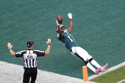 <div class='meta'><div class='origin-logo' data-origin='AP'></div><span class='caption-text' data-credit='AP Photo/Michael Perez'>Philadelphia Eagles' Nelson Agholor celebrates as he crosses the goal line to score a touchdown during the second half of an NFL football game against the Arizona Cardinals.</span></div>