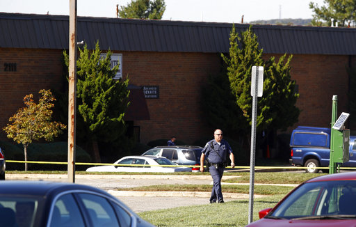 <div class='meta'><div class='origin-logo' data-origin='none'></div><span class='caption-text' data-credit='AP'>A law enforcement official walks away from the scene of a fatal shooting at a business park in the Edgewood area of Harford County, Md., Wednesday, Oct. 18, 2017.</span></div>