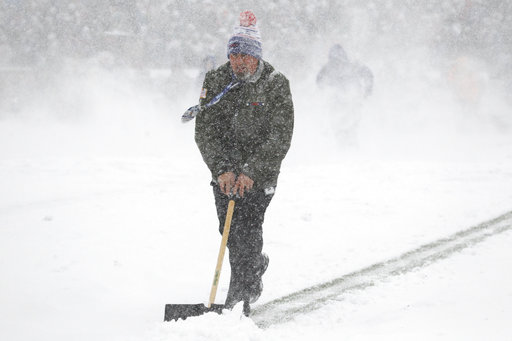 """<div class=""""meta image-caption""""><div class=""""origin-logo origin-image ap""""><span>AP</span></div><span class=""""caption-text"""">A man tries to clear snow off the field during the first half of an NFL football game between the Buffalo Bills and the Indianapolis Colts, Sunday, Dec. 10, 2017. (AP Photo/Jeffrey T. Barnes)</span></div>"""