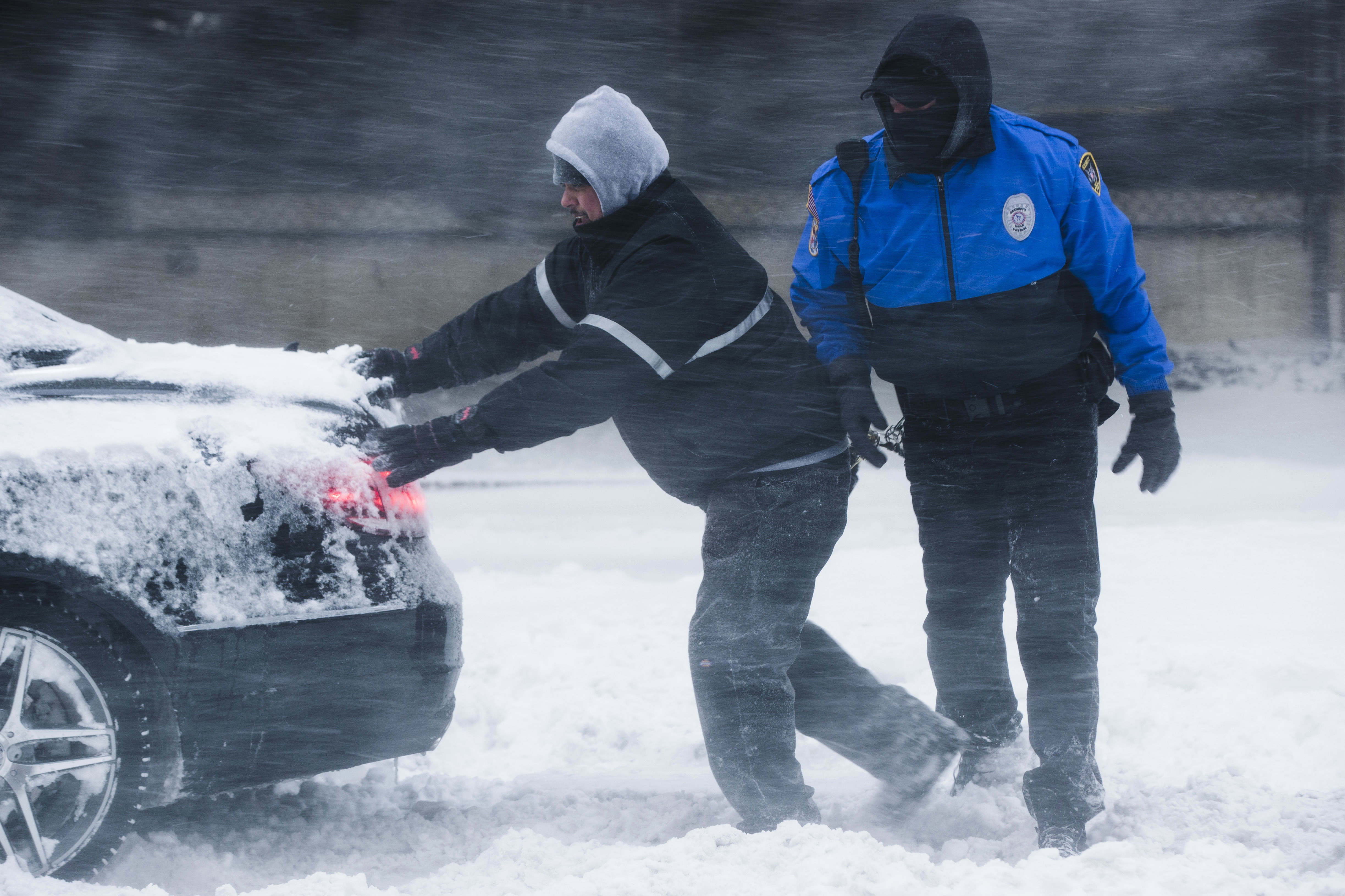 "<div class=""meta image-caption""><div class=""origin-logo origin-image none""><span>none</span></div><span class=""caption-text"">Men work to free a stranded car during a winter snowstorm in Atlantic City, N.J., Thursday, Jan. 4, 2018. (AP Photo/Matt Rourke) (AP)</span></div>"