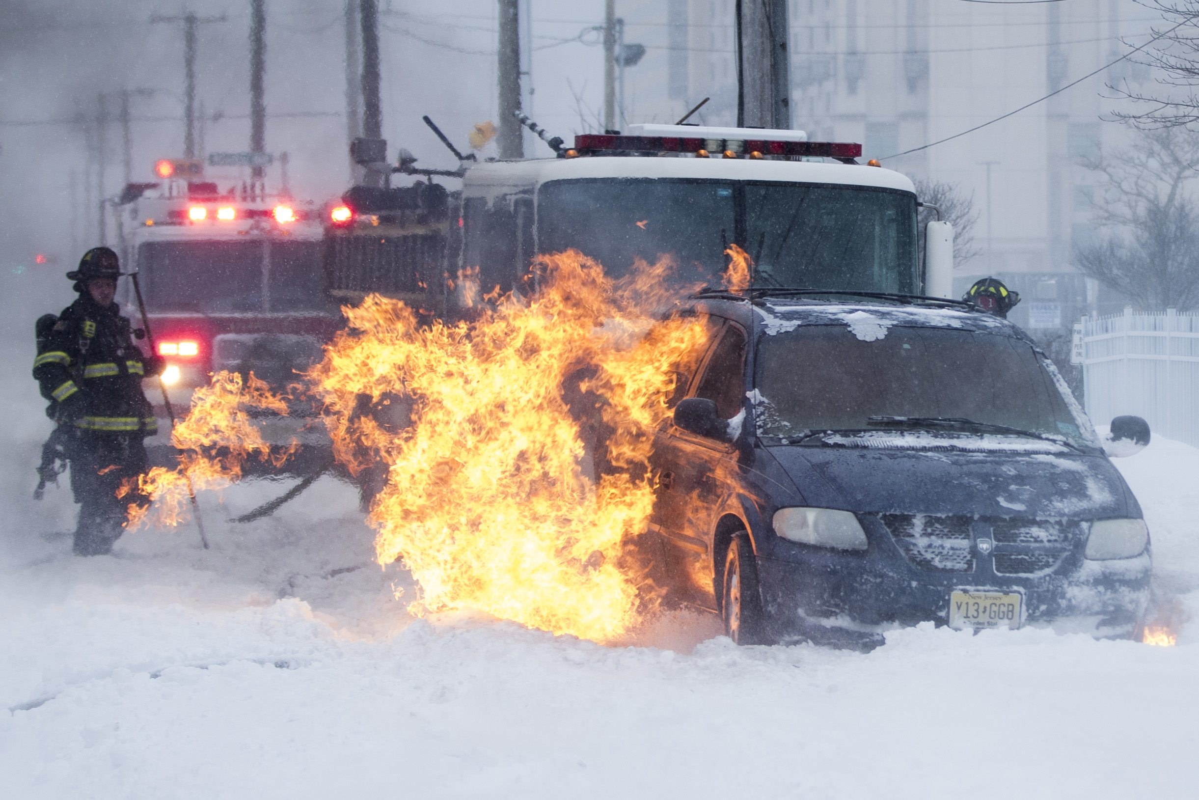 "<div class=""meta image-caption""><div class=""origin-logo origin-image none""><span>none</span></div><span class=""caption-text"">Firefighters extinguish a vehicle fire during a winter snowstorm in Atlantic City, N.J., Thursday, Jan. 4, 2018. (AP Photo/Matt Rourke) (AP)</span></div>"