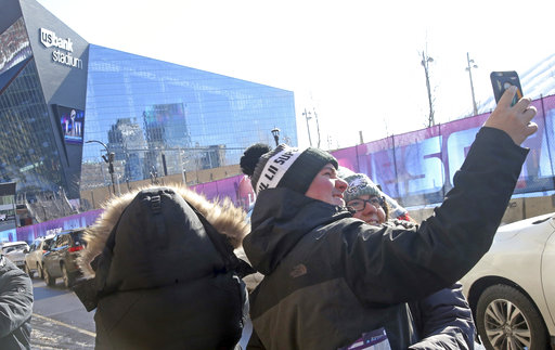 <div class='meta'><div class='origin-logo' data-origin='none'></div><span class='caption-text' data-credit='AP'>Philadelphia Eagles fans take a photo together with U.S. Bank Stadium in the background Sunday, Feb. 4, 2018, in Minneapolis. AP Photo/Jim Mone)</span></div>
